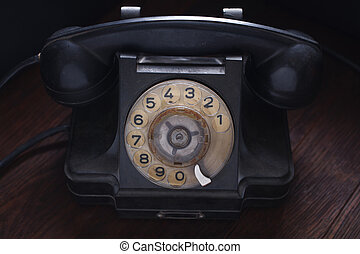 Old retro phone on wooden board