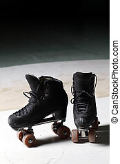 Old retro roller skates front view