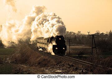 Old retro steam train - Vintage steam train passing through...