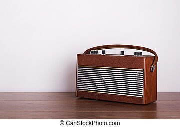 Old retro style radio on a wooden surface
