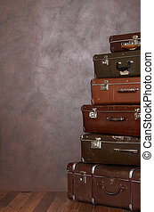 Old retro suitcases at a wall - The old retro suitcases at a...