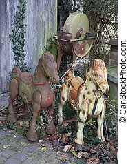 Old rocking horses - Old rusty metal rocking horses and...