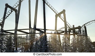 old roller coaster at sunset in forest