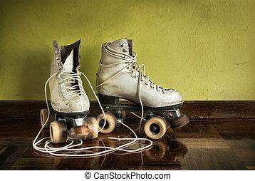Old Roller-Skates - Old worn roller skates with big...