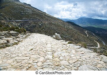 ancient roman roadway at gredos mountains in avila spain