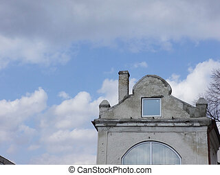 Old Roof Against the Background of the Sky