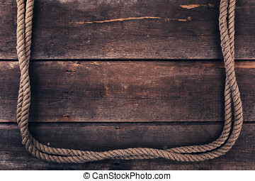 old rope on wood plank background