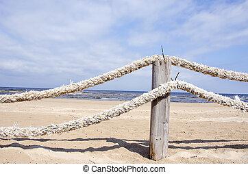 ropes fence on resort beach nea sea