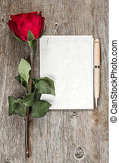 Old rose and blank paper - copy space