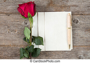 Old rose and blank paper sheets