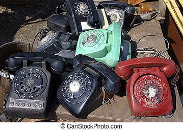 Old rotary phones. - Stack of old broken rotary telephones...