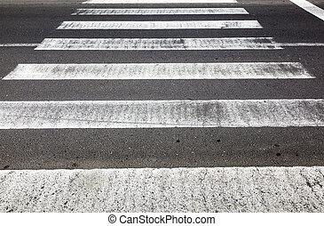 old rotten pedestrian crossing stripes
