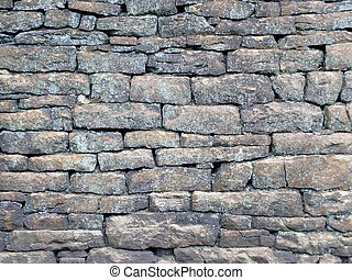 old rough grey stone wall