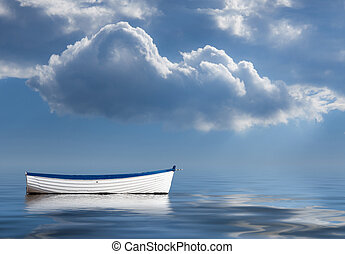 Old rowing boat marooned at sea - Concept image of...