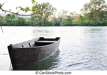 Old rowing boat on the river