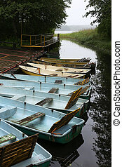Old rowing boats on a wooden pier