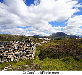 old ruin and highlands landscape - old stoned ruin and...