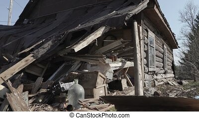 old ruined abandoned wooden house.