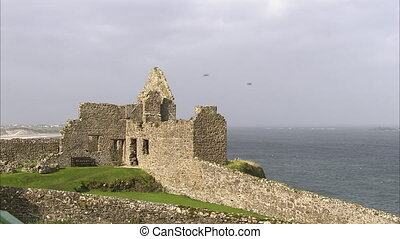 Old ruined castle near the ocean - An extreme long shot of a...