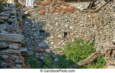 Old ruined house with stone walls