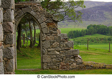 Old ruins of the church in Scotland in summer day