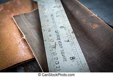 old ruler and sandpaper