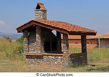 Old small run down house outside on rural lawn grass