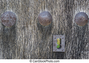 Old run-down wooden door and lock - Closeup of vintage...