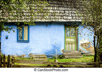 Old rural house in autumn forest