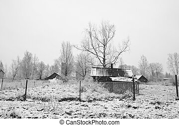 old rural house on snow field
