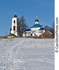Old russian country church in winter time