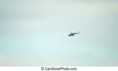 Old russian helicopter flying in the sky