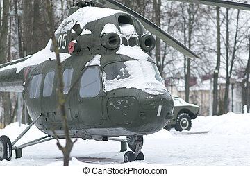 Old Russian helicopter in the snow