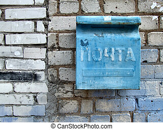 Old Russian postbox - Old blue mailbox in Russia. Cyrillic...