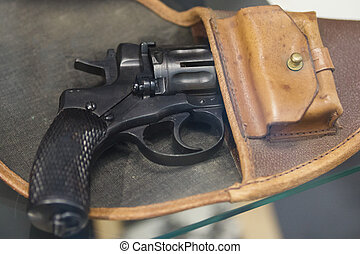 Old Russian revolver in a holster - soviet weapon