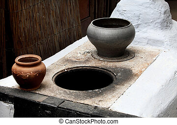 old Russian stove and a metal pot for cooking in the oven