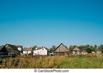 Old Russian Traditional Wooden Houses In Village Or Countryside