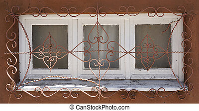 Old rust window with styled iron grid