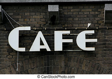 Old rusted cafe sign