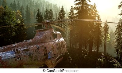 old rusted military helicopter in the mountain forest at...