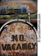 Old rusted vintage Motel no Vacancy Sign and Rusted Car trunk with peeling paint on route 66