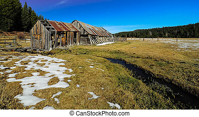old rustic barn with snow