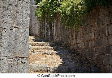 Old rustic coastal village path lane made of stone