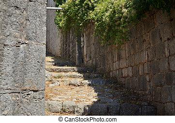 Old rustic coastal village path lane made of stone