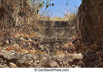 Old rustic village stone stairs