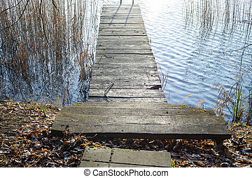 Old rustic wooden steps leading to a jetty