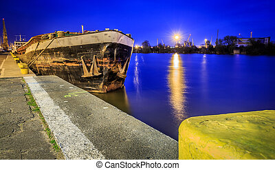 Old rusty barge at night