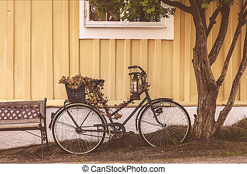 Old rusty bicycle in front of a Swedish house