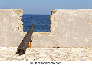 Old rusty cannon at the fortress of Firka. Greece.