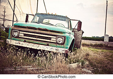 Old rusty car in abandoned town along historic US Route 66. Vintage processing